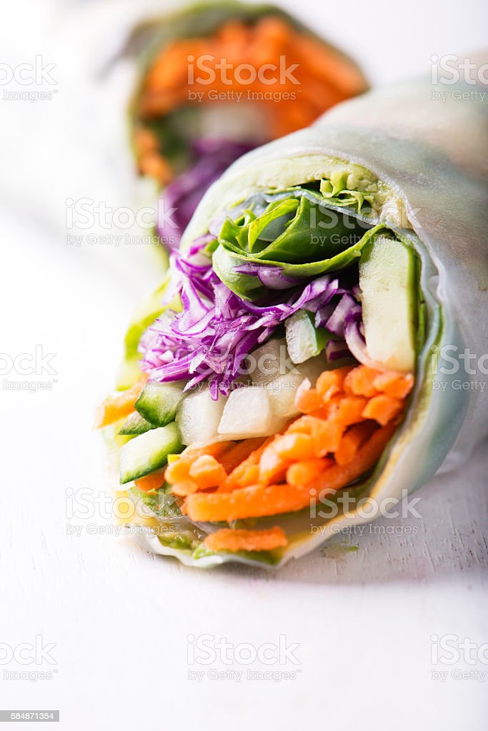 vegan rice paper spring rolls with veggies on white stock photo