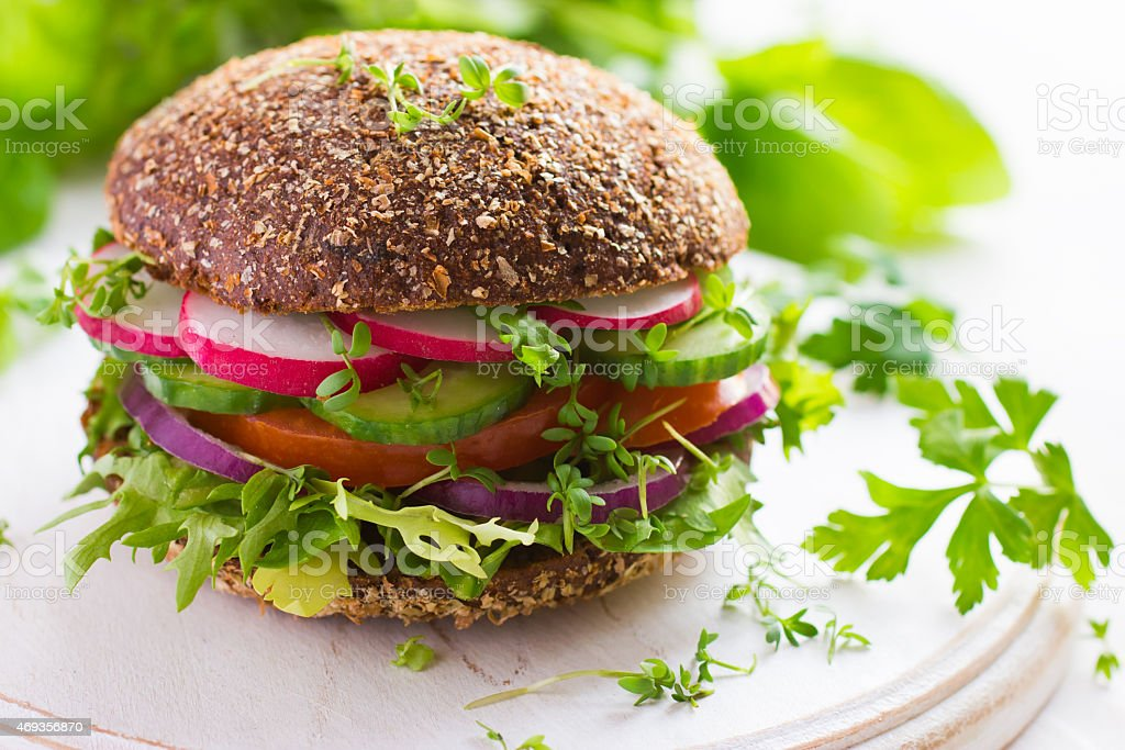 Vegan rye burger with fresh vegetables stock photo