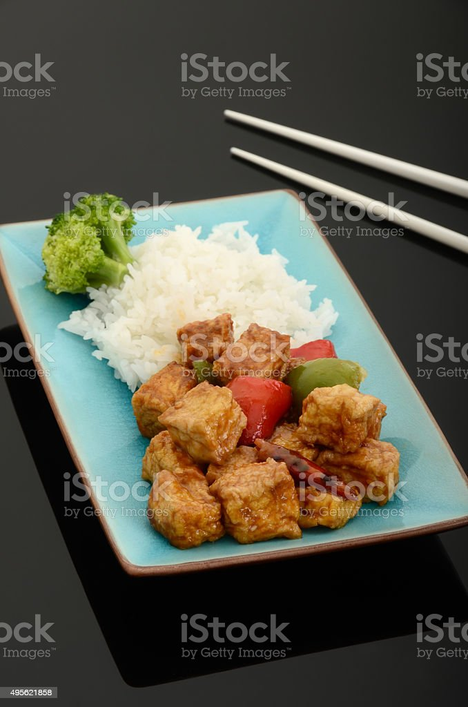 Vegan Spicy Stir-Fried Tofu with Peppers stock photo