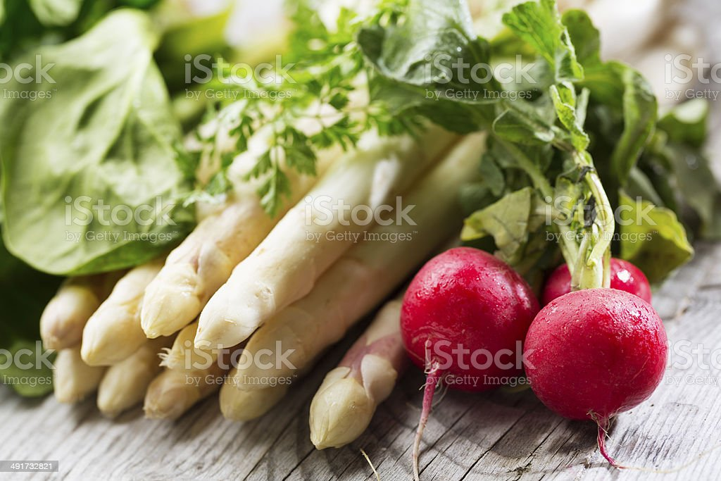 vegan spring vegetables spinache radishes asparagus and chervil royalty-free stock photo