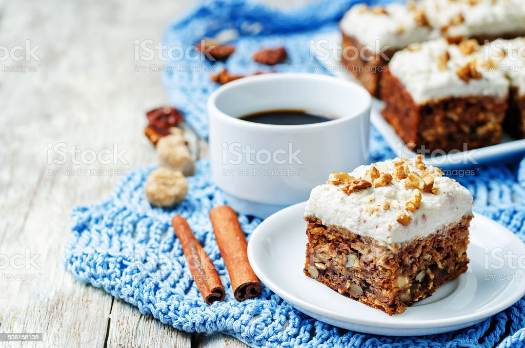 vegan walnuts carrot cake with cashew cream frosting stock photo