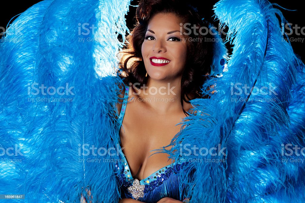 Vegas showgirl with blue feathers stock photo