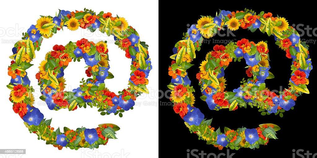 Vegetable alphabet. Arroba sign of flowers stock photo