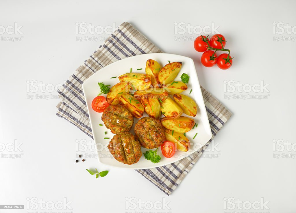 vegetable and cheese patties with potato wedges stock photo