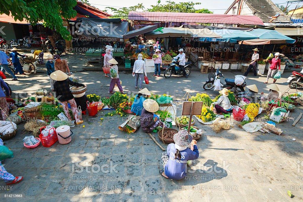 Vegetable and fruit vendors at Hoi An market, Vietnam stock photo