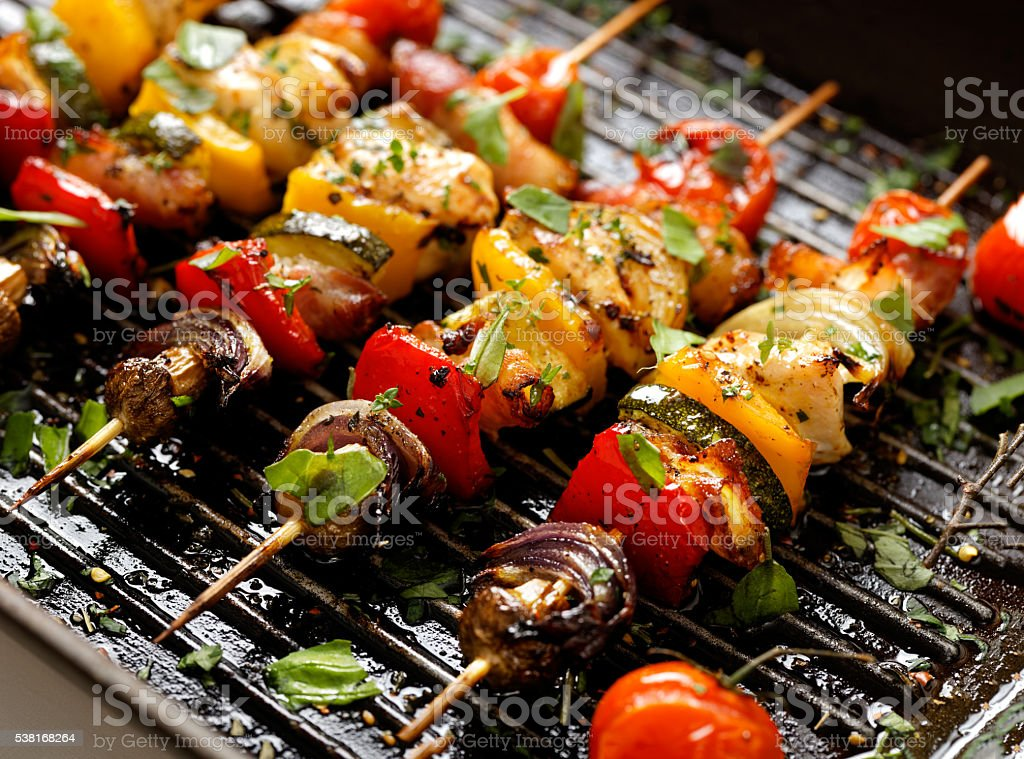 Vegetable and meat skewers in a herb marinade stock photo