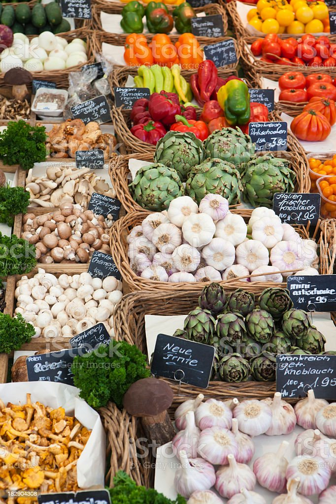 Vegetable and mushrooms on market stall royalty-free stock photo