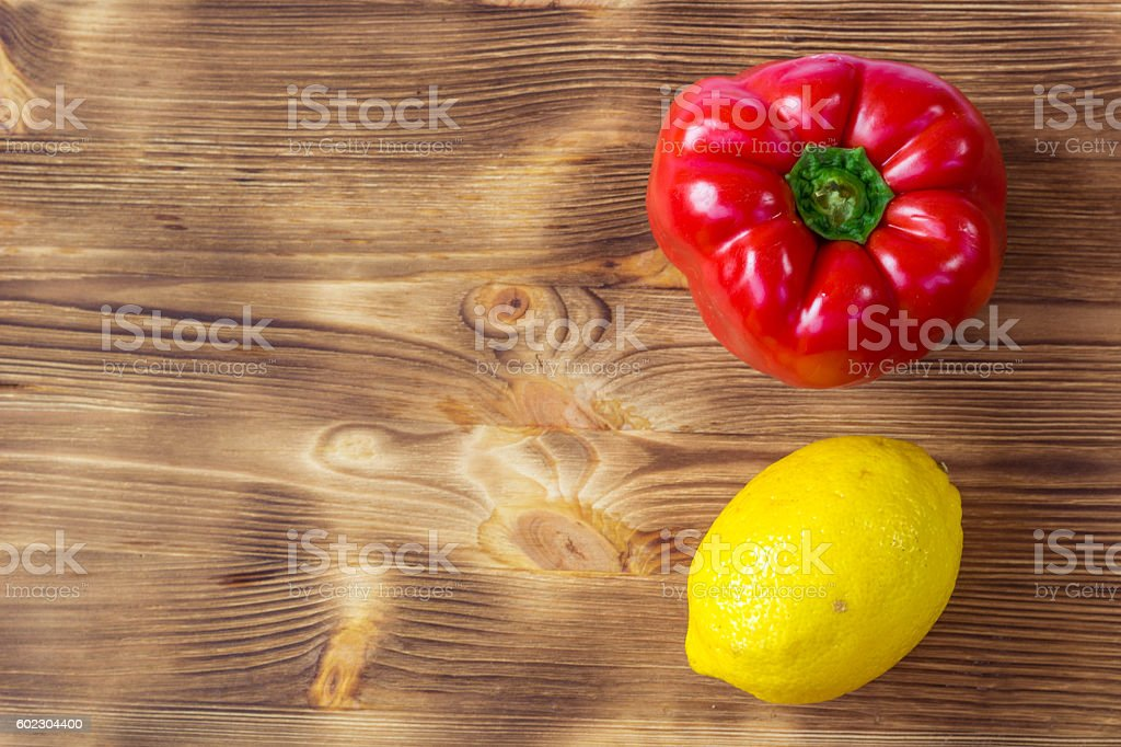 Vegetable background for postcard with red pepper and lemon stock photo