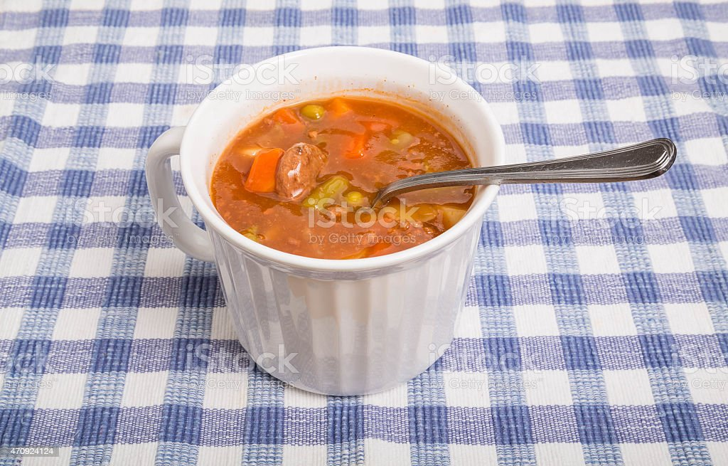 Vegetable Beef Soup in White Mug stock photo