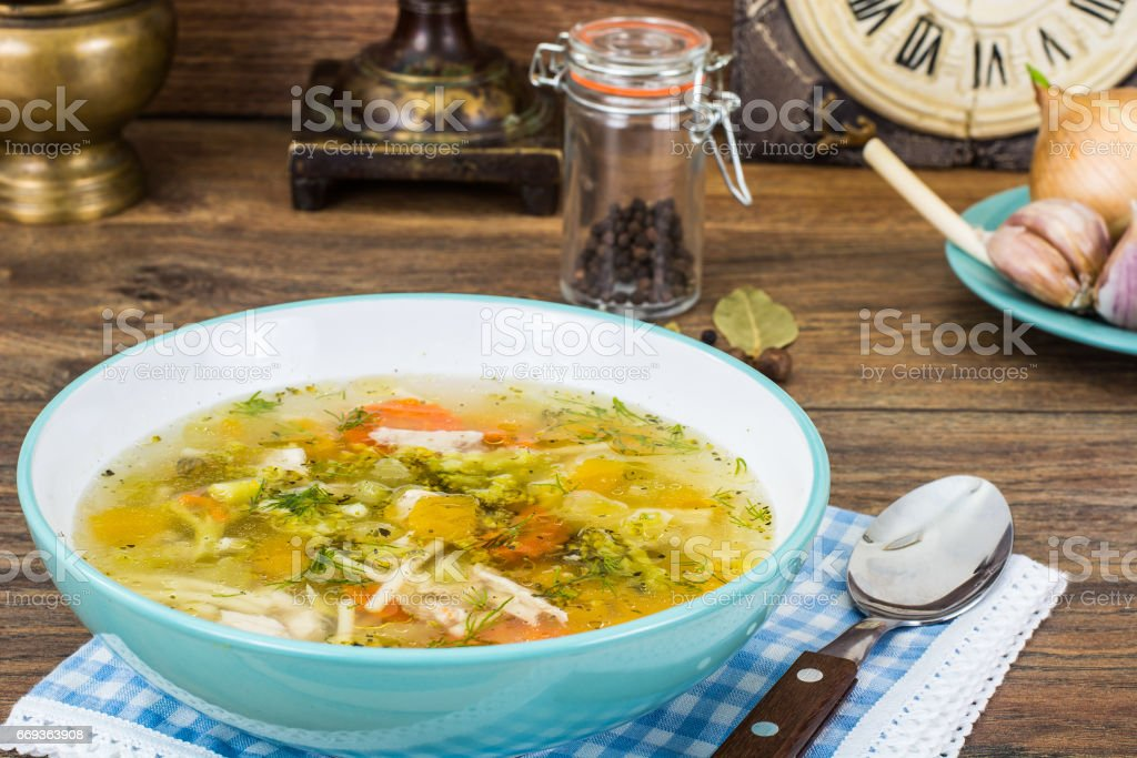 Vegetable broth with pumpkin and noodles stock photo