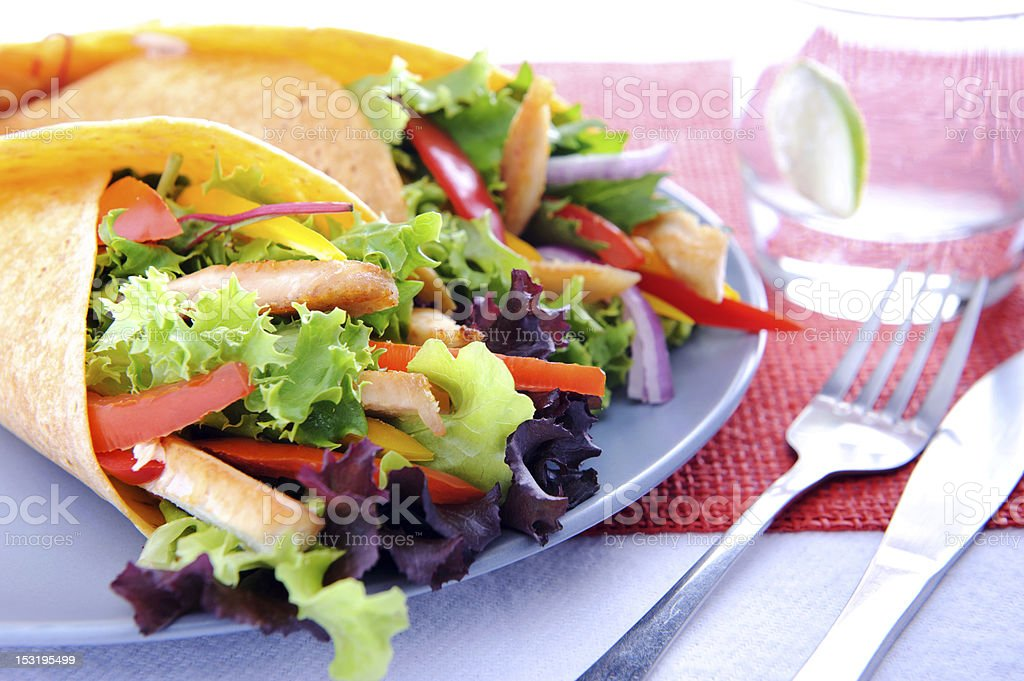 Vegetable burrito with chicken and cutlery royalty-free stock photo