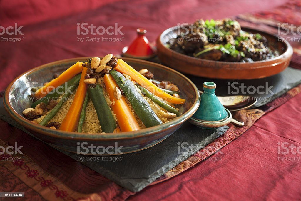 Vegetable couscous and Meat Tagine stock photo