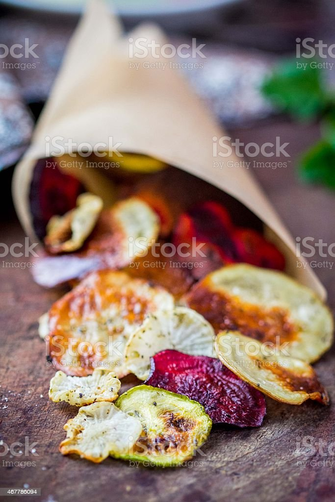 Vegetable crisps, potatoes, beets, zucchini in paper, vegetarian stock photo