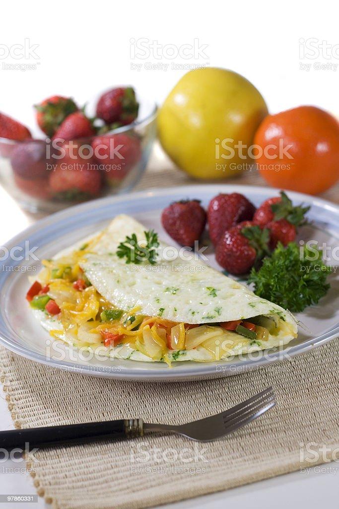 Vegetable egg white omelet with fresh fruit stock photo