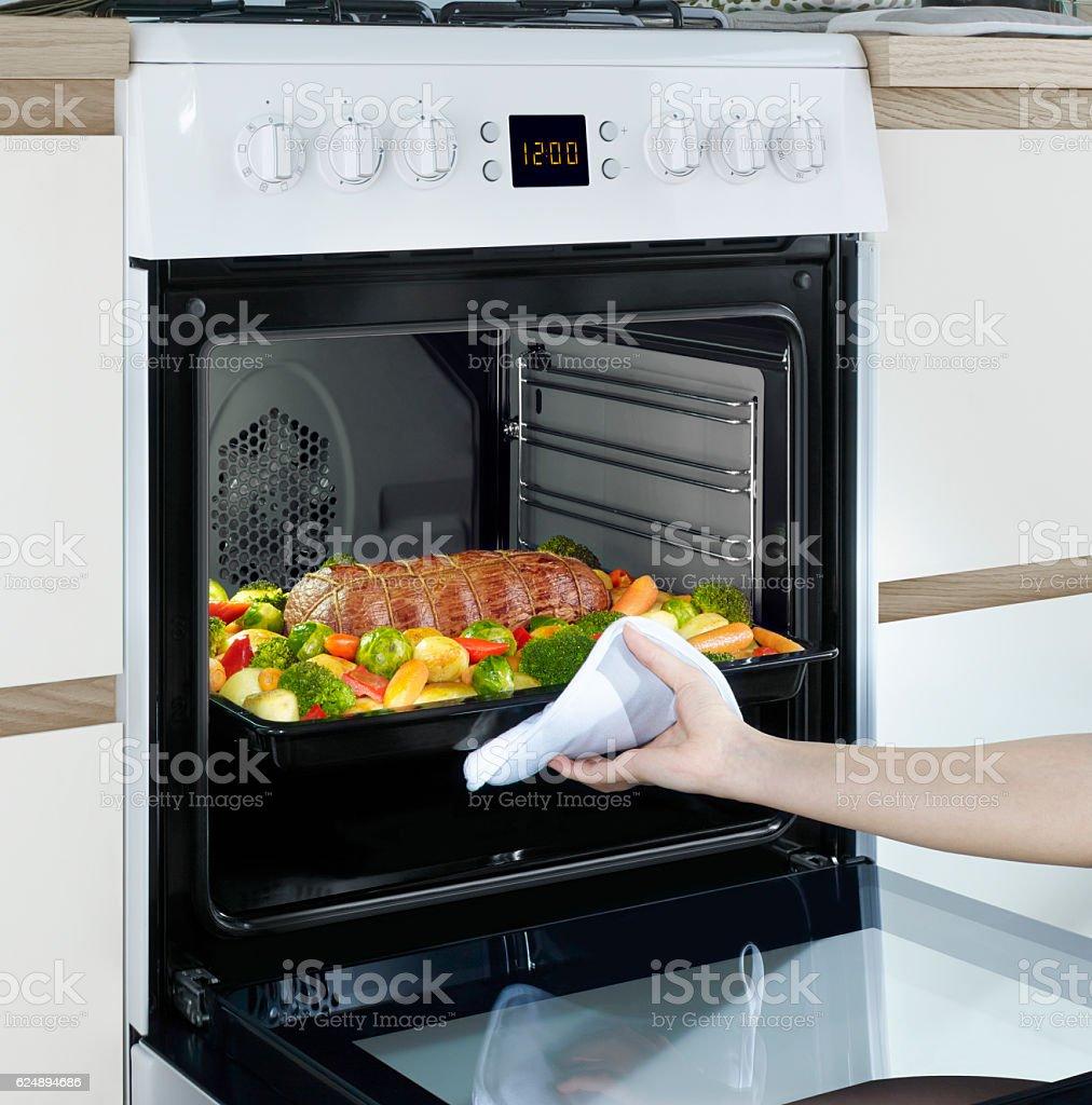 Vegetable garnish in the oven steak stock photo