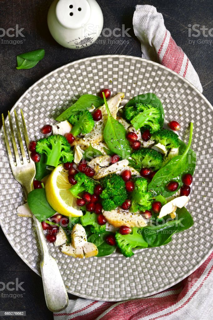 Vegetable green salad with chicken and pomegranate stock photo