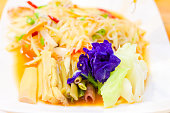vegetable in dish with salad papaya on table