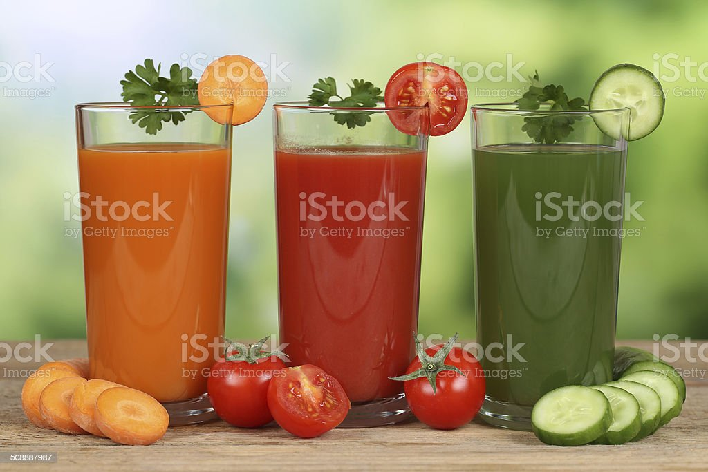 Vegetable juice from carrots, tomatoes and cucumber stock photo