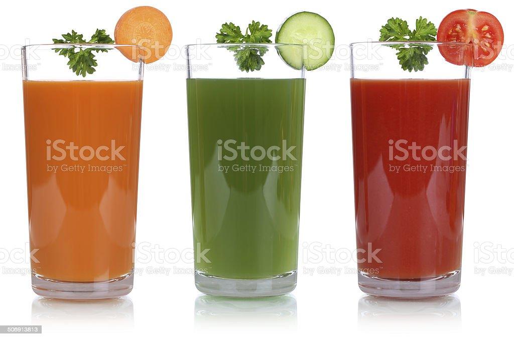 Vegetable juice like carrot juice and tomato juice isolated stock photo