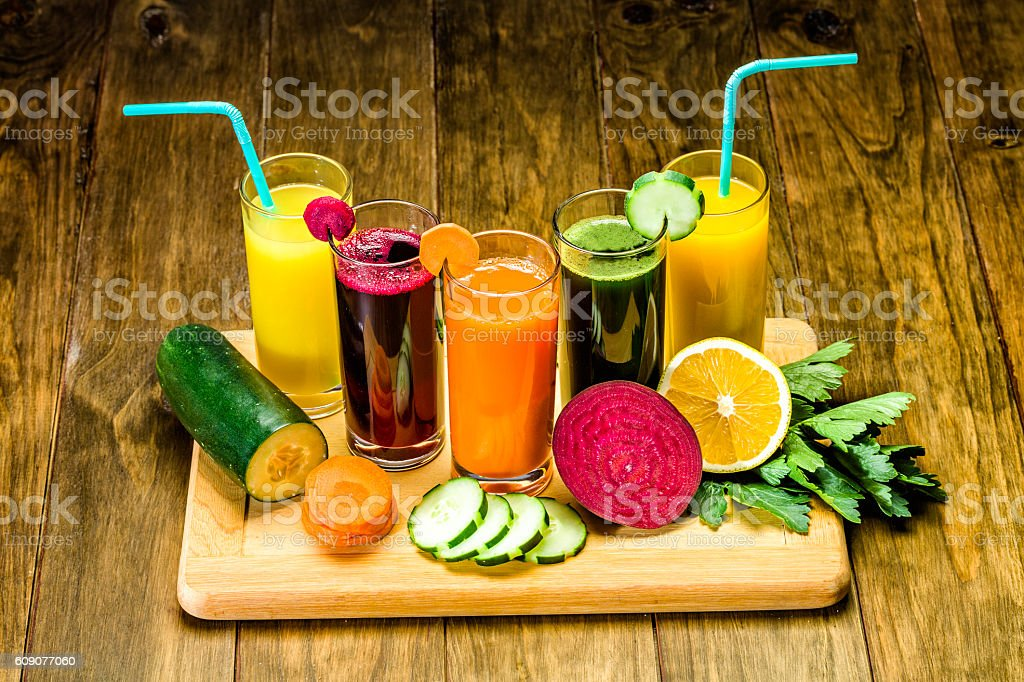 Vegetable juice variety on a wooden table - Dieting concepts stock photo