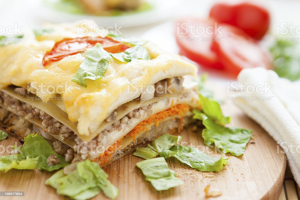 Vegetable lasagna on a wooden board royalty-free stock photo
