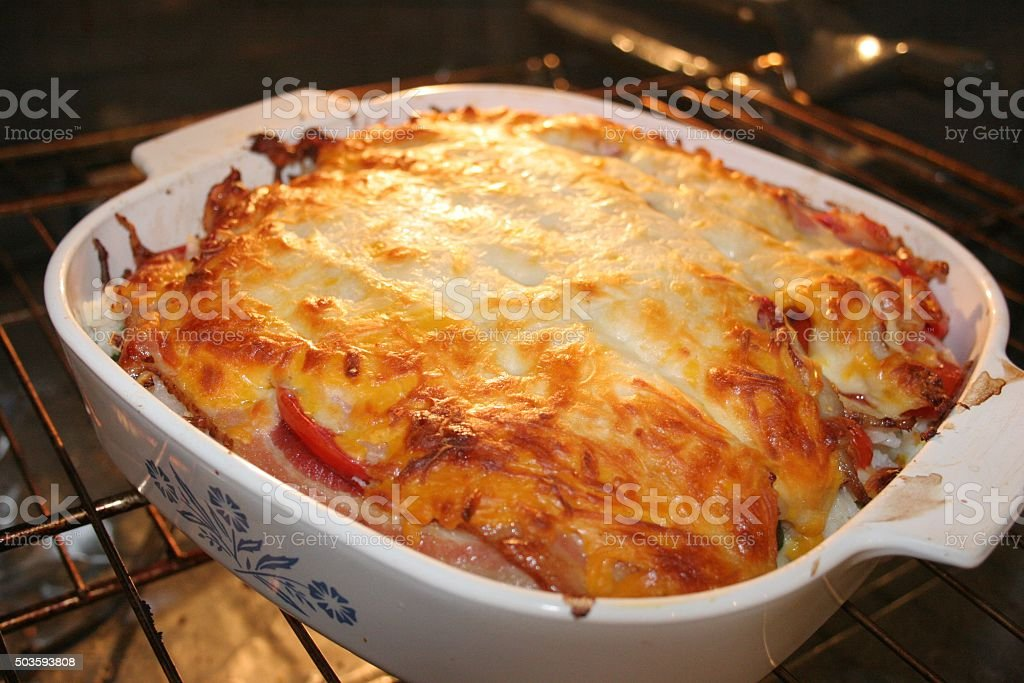 Vegetable Lasagna With Bacon in the Oven stock photo