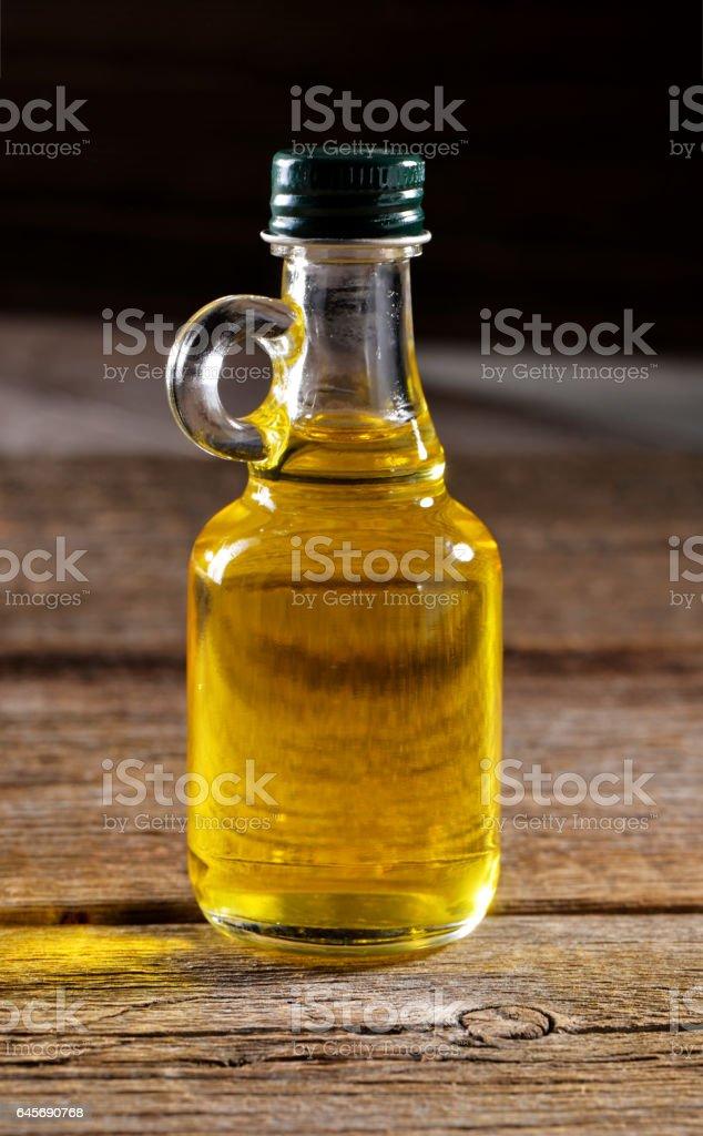 vegetable oil  bottle on wooden background stock photo