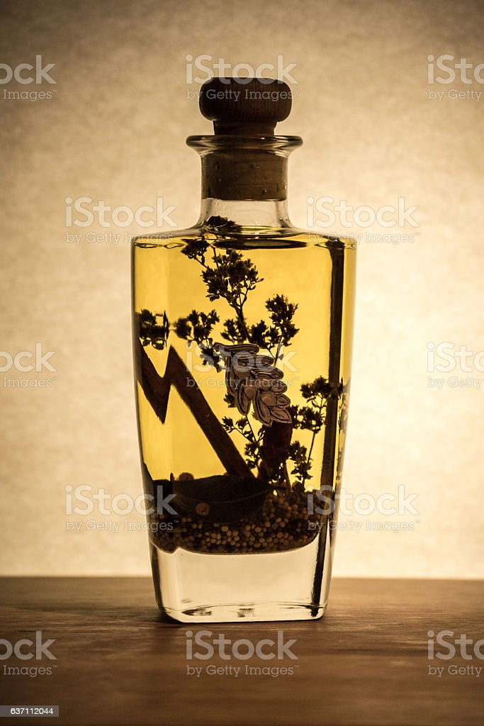 Vegetable oil with spices in a bottle stock photo