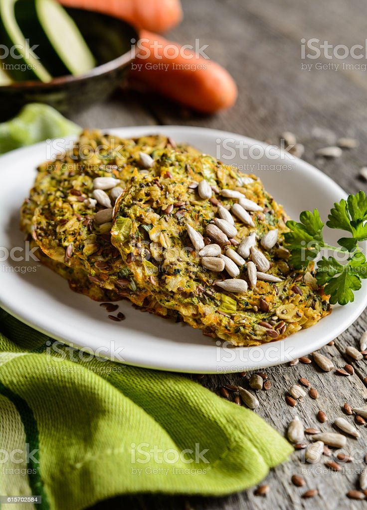 Vegetable pancakes with zucchini, carrot, chia, flax seeds and oatmeal stock photo