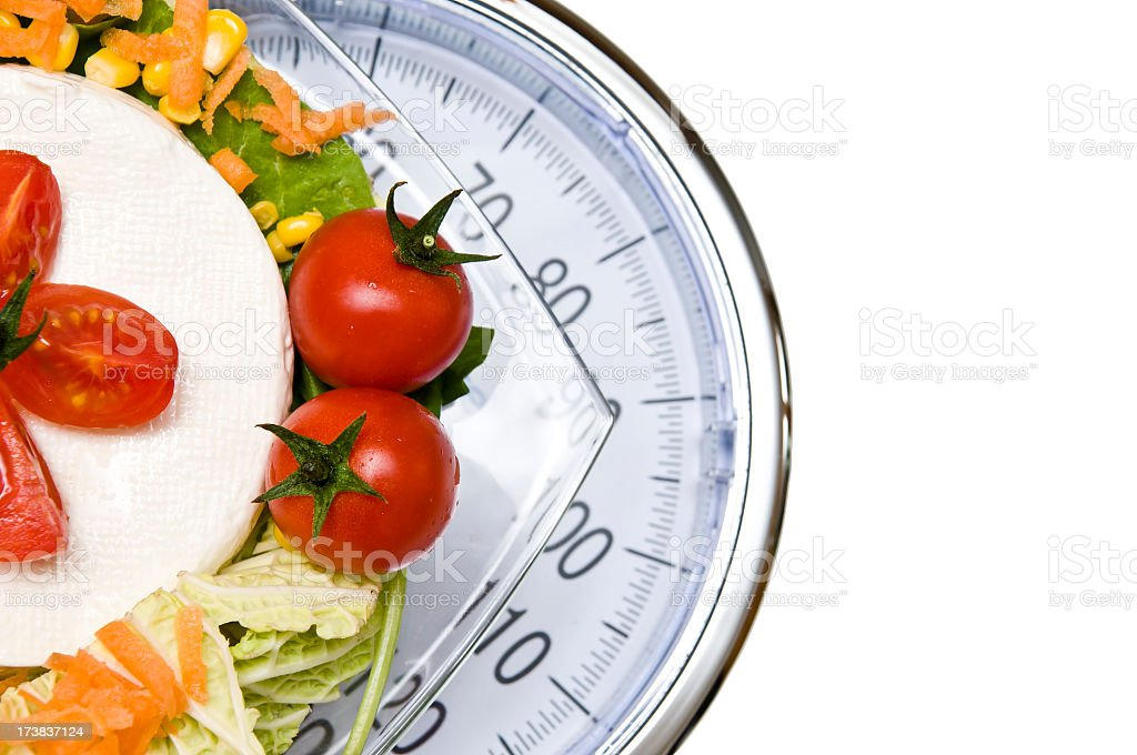 A vegetable platter on top of a scale royalty-free stock photo