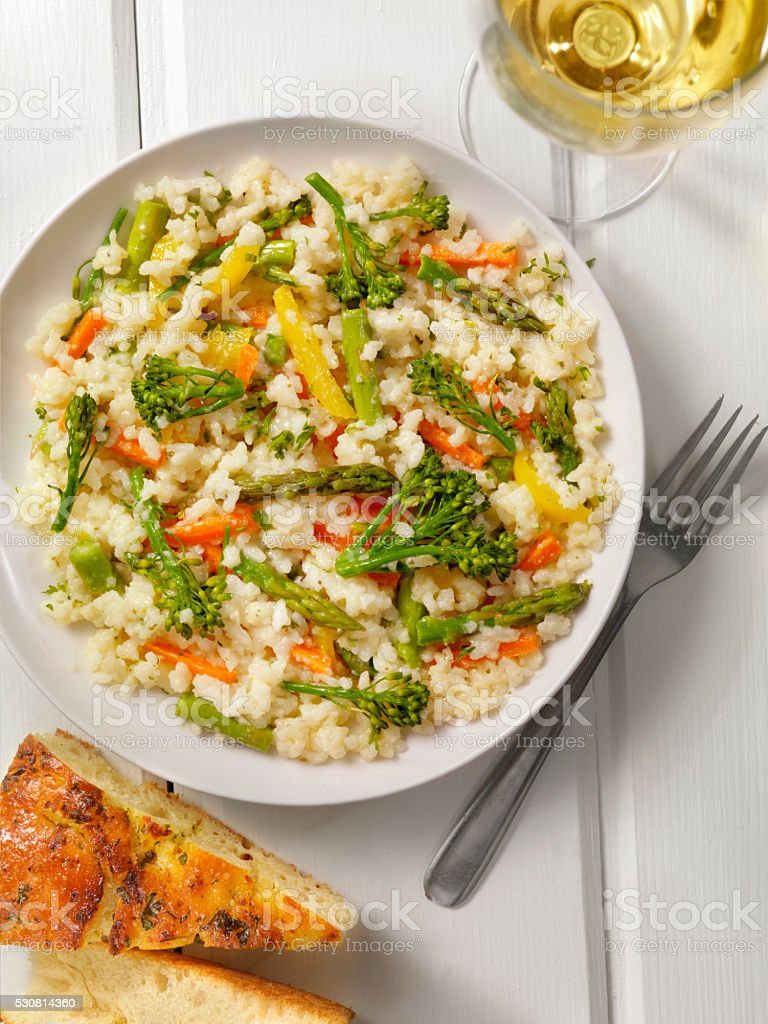Vegetable Risotto with Fresh Parsley and Focaccia Bread stock photo