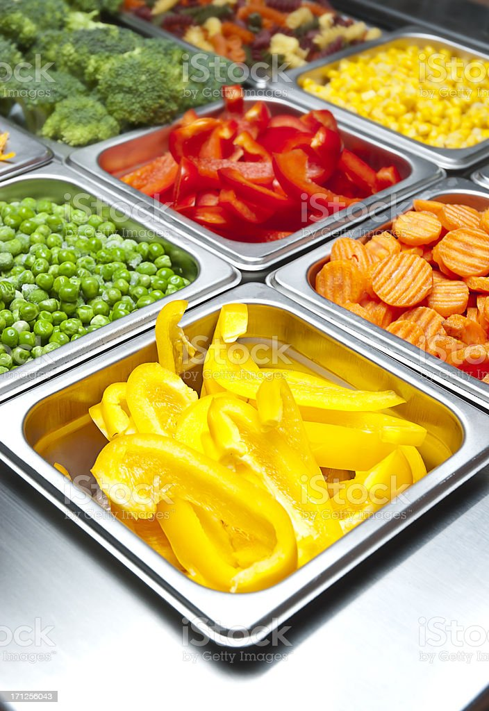 Vegetable salad bar with peppers, carrots, and peas stock photo