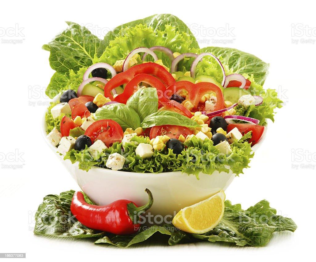 Vegetable salad bowl isolated on white royalty-free stock photo