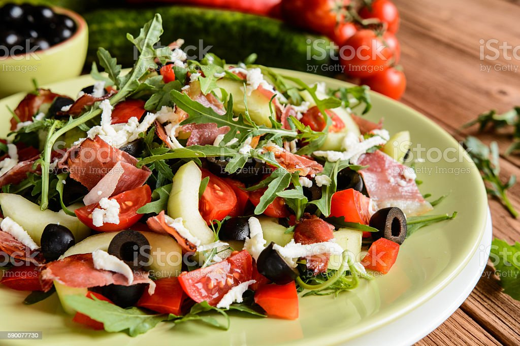 Vegetable salad with Black Forest ham and arugula stock photo