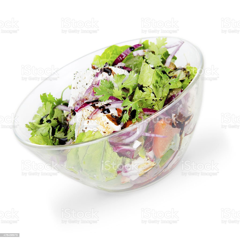 vegetable salad with goat cheese. isolated on white background royalty-free stock photo
