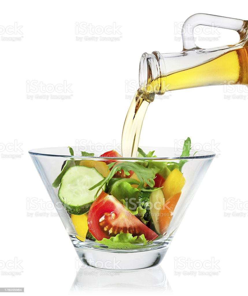 Vegetable salad with olive oil on white background. Clipping path stock photo