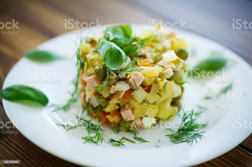 vegetable salad with pickled cucumbers stock photo