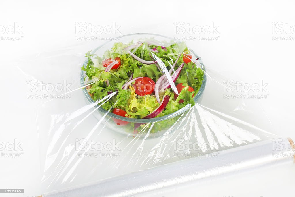 vegetable salad with plastic film stock photo