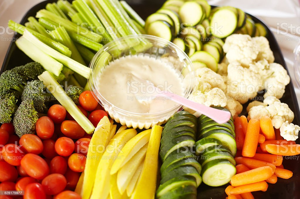 Vegetable Salad With Ranch Dressing Served At Birthday Party stock photo