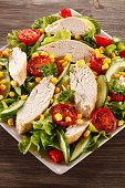 Vegetable salad with roasted chicken meat
