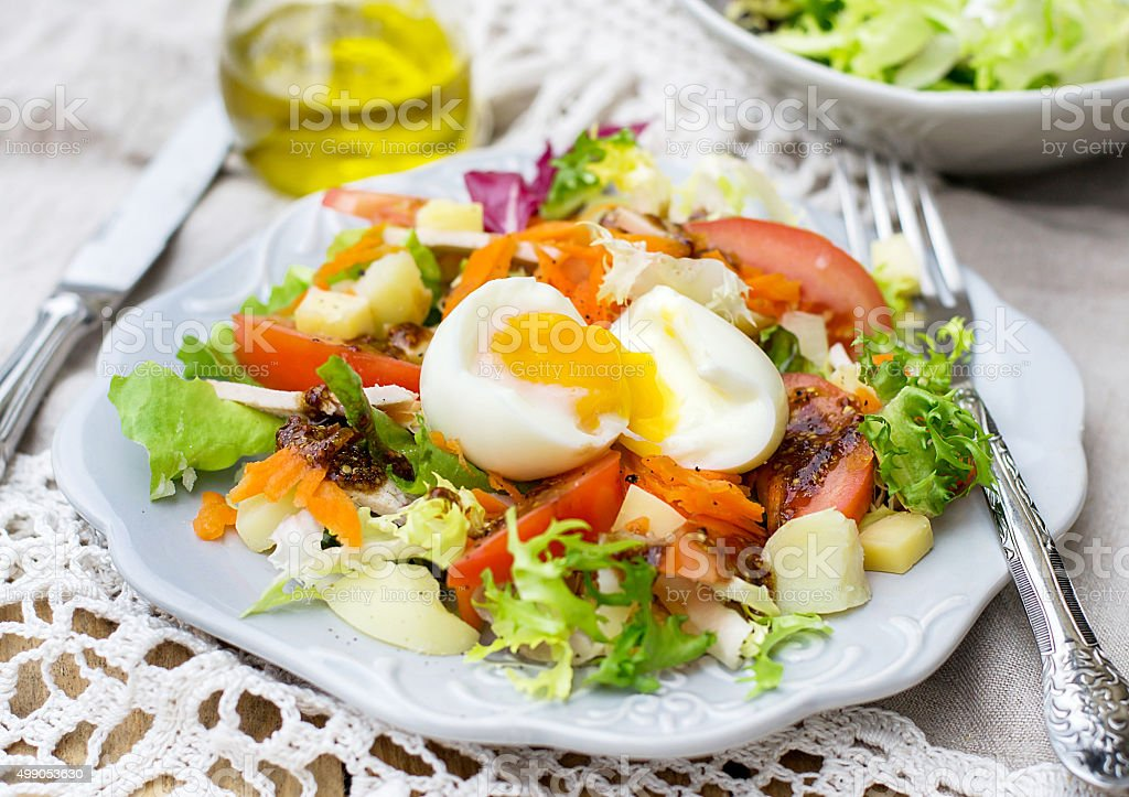 Vegetable salad with soft-boiled egg stock photo