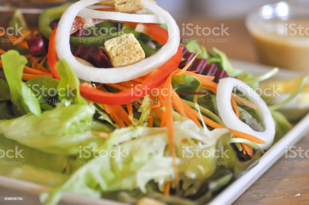 vegetable salad with thousand island dressing stock photo