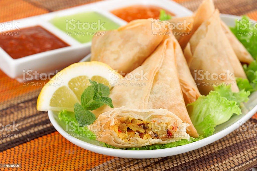 vegetable samosa with indian sauce stock photo