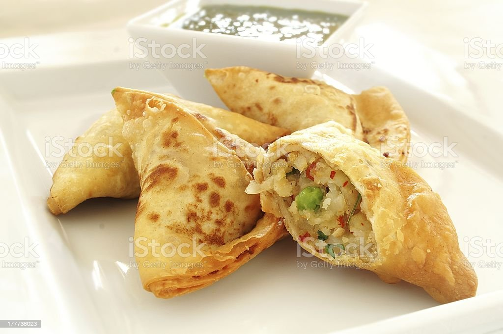 vegetable samosas with Llal dip stock photo