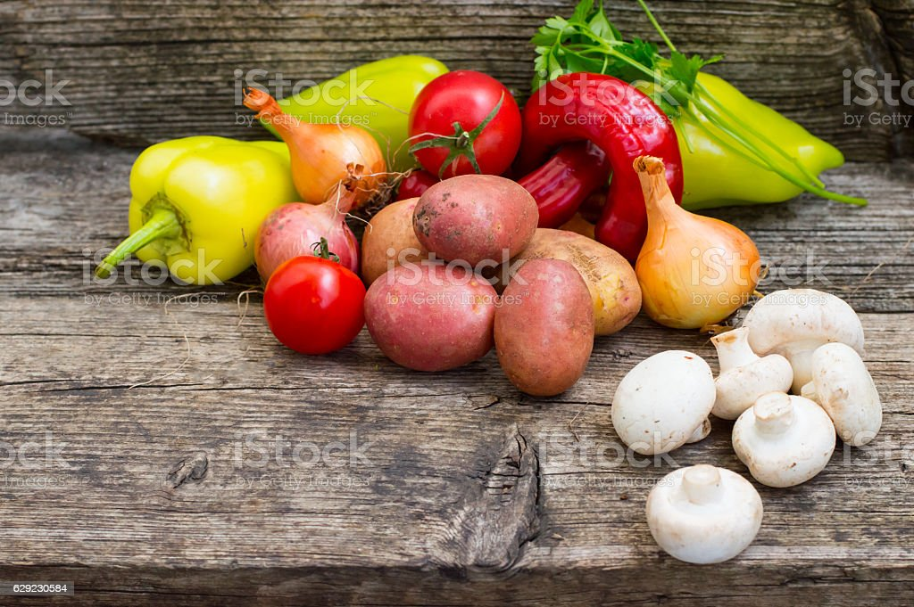 Vegetable set on a wooden background. Close-up stock photo