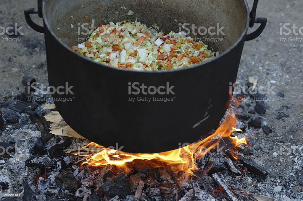 Vegetable soup cooking in a caldron royalty-free stock photo