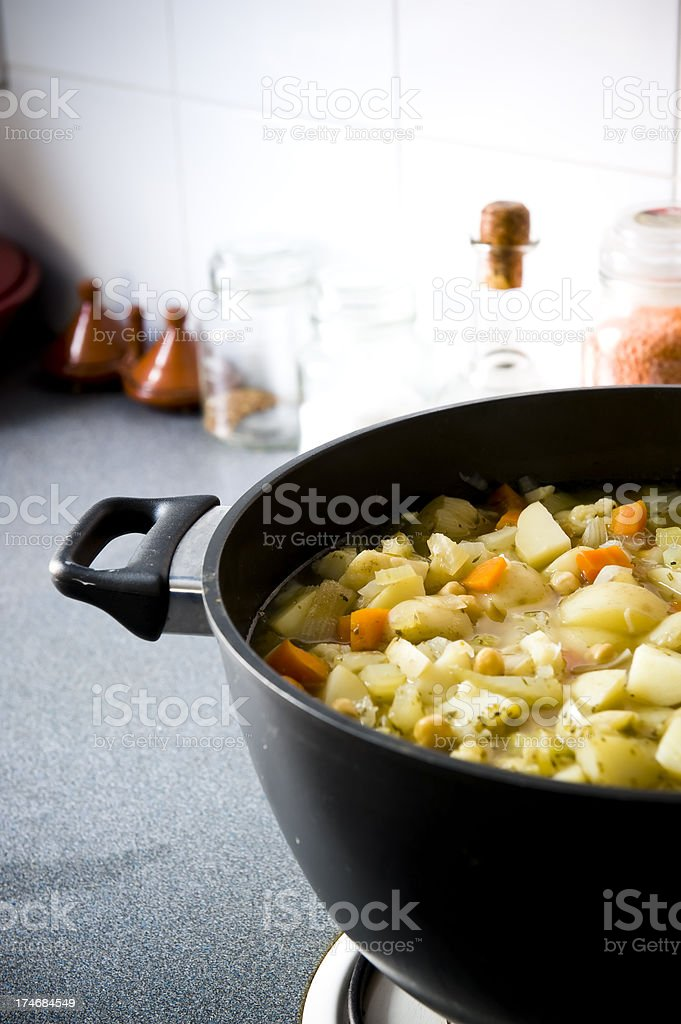Vegetable soup cooking stock pot gas stove stock photo