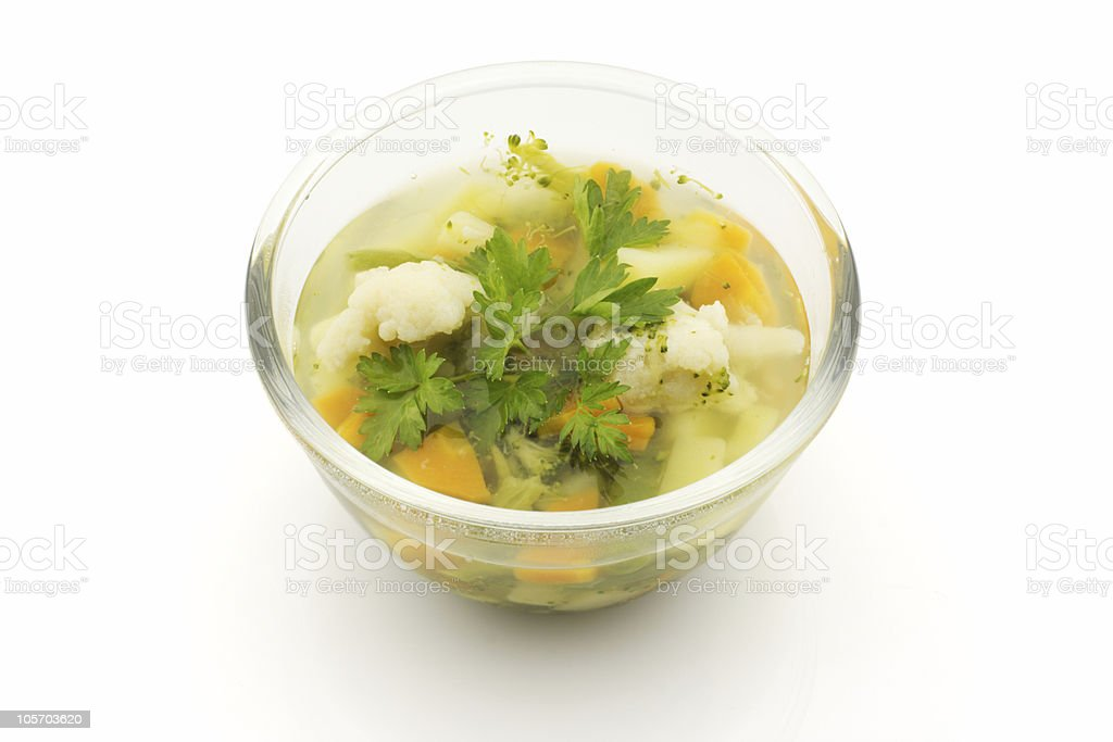 Vegetable soup in a glass bowl, isolated royalty-free stock photo