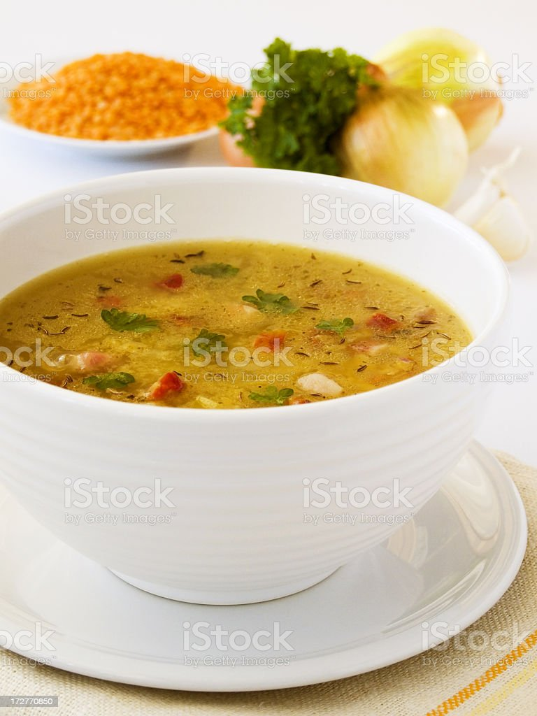 Vegetable soup in a white ceramic bowl stock photo