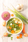 vegetable soup in bowl with ingredients